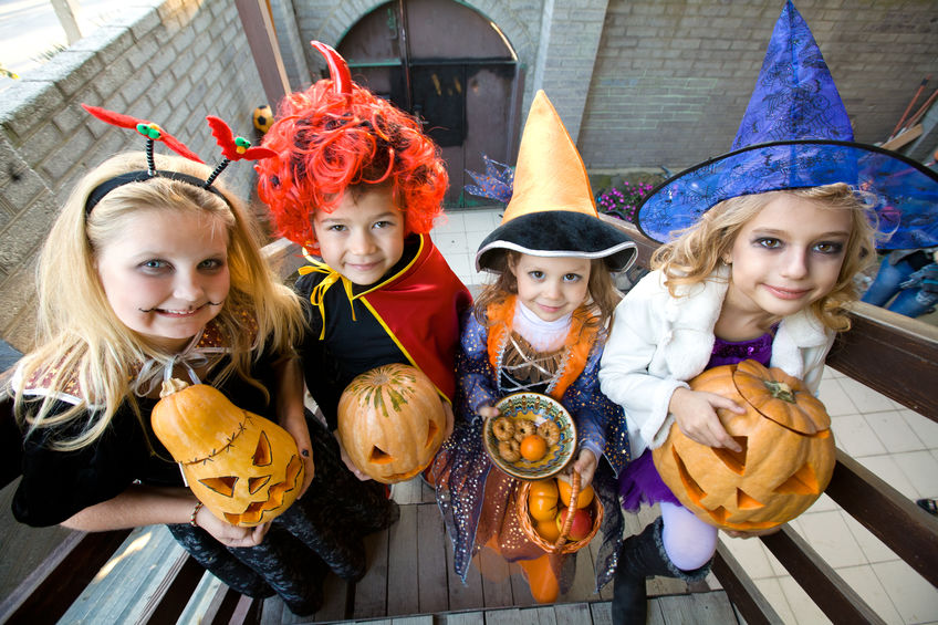 children in halloween costumes trick-or-treating